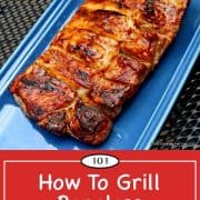 image for Pinterest of a grilled slab of boneless pork ribs on a blue plate